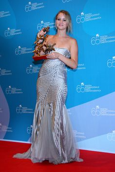 """Jennifer Lawrence Photos Photos - Actress Jennifer Lawrence poses with Marcello Mastroianni Award for Best Young Actress for the movie """"The Burning Plain"""" at the 65th Venice Film Festival Closing Ceremony Press Conference at the at the Sala Grande on September 6, 2008 in Venice, Italy. - 65th Venice Film Festival: Closing Ceremony - Press Conference"""