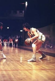 Sock it to 'em Pete Maravich, who played for the Hawks, Jazz and Celtics from was one of the greatest shooters, best ball-handlers and worst defenders in NBA history. He also wore the floppiest socks. Football And Basketball, College Basketball, Basketball Players, Pistol Pete, Nba Fashion, Dennis Rodman, Allen Iverson, High School Football, Basketball Association