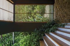 Commissioned by a couple with three young children, this weekend house, located one and a half hours from São Paulo, is built on sloping terrain surrounded by an important Atlantic Forest reserve. The intervention began with the study of the topograph...