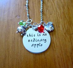 "Snow White Inspired Necklace. Poison Apple. Evil Queen Villain. ""This is no ordinary apple"". Wicked Queen. Silver colored. Swarovski crystal"