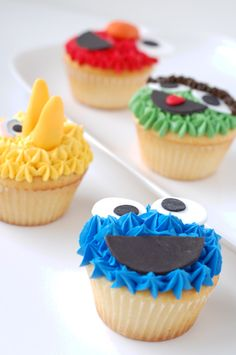 Sesame Street cupcakes by CharmPastry - Cookie Monster, Big Bird, Elmo, and Oscar! Lemon vanilla cupcakes with fondant face details.