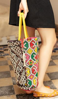 this bag feels like a summer breeze. love the contrasting moroccan textiles and the cute little tin fish charm. NEED!