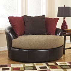 L6.2   $434.60 Sanya Mocha Oversized Swivel Accent Chair.  Also comes with beige accent pillow instead of maroon and that one is only $416.23