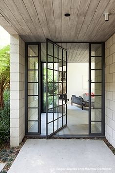 Love metal framed windows/doors - this is like old windows on a warehouse.