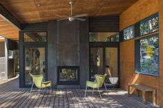 The outdoor living/dining room with double-sided fireplace. Tagged: Outdoor and Wood Patio, Porch, Deck. Photo 9 of 9 in Large Windows and Glazed Doors Let This Modern Cabin Mingle With Nature from Lot Browse inspirational photos of modern outdoor spaces. Indoor Outdoor Fireplaces, Outdoor Rooms, Outdoor Living, Fireplace Outdoor, Country Fireplace, Farmhouse Fireplace, Concrete Fireplace, Fireplace Design, Fireplace Cover