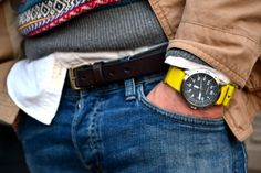 A great layered look with a oxford shirt and fairisle sweater. The detail of the watch yellow picks up a color in the sweater.  Really works.