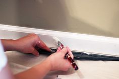 The Beginner's Guide to Patching and Painting Baseboards Caulk Paint, Painting Baseboards, Painting Trim, Narrow Hallway Decorating, Floating Stairs, Remodels And Restorations, Diy House Projects, Staircase Design, Wainscoting