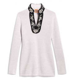 Super soft and cozy with a dose of embellishment, the Tory Burch Cormac Tunic will quickly be one of your go-to closet companions.