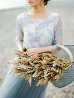 wedding inspiration with pale blue and wheat - photo by Muravnik Photography http://ruffledblog.com/calming-baltic-sea-wedding-inspiration