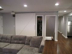 sliding barn door to basement/closet