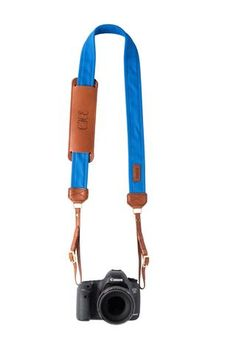 FOTO | Cobalt Fotostrap - a blue canvas and genuine leather camera strap that can be personalized with a monogram or business logo, making it the perfect personalized gift!