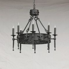 A simple gothic beauty. ima sucker for fleur-de-lis. and it has just that right spanish inquisition austerity wrought into it too :D Round Chandelier, Chandelier In Living Room, Linear Chandelier, Vintage Chandelier, Wrought Iron Chandeliers, Large Chandeliers, Ceiling Fixtures, Ceiling Lights, Metal Bending Tools