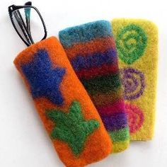 We don't often find gorgeous handmade products that serve two purposes! These fun felted wool cases are the perfect size to protect your eyeglass. They also work wonderfully as a sleeve to protect you