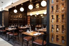The gastropub's interior design is modern with traditional accents. - leather panels, rich materials
