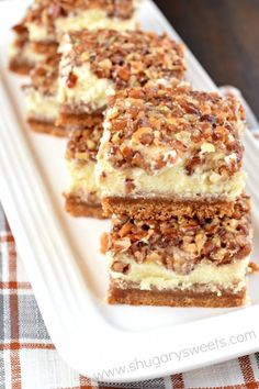 Incredibly delicious, Pecan Pie Cheesecake Bars are the perfect recipe for your holiday dessert table!!