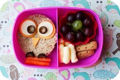 Owl bento I used a large circle cutter for the owl, a smaller one for the outside part of his eyes and an even smaller one for the whites. His pupils and feet are black olives and he sits on a branch of carrots In the next section, she has some grapes, graham cracker sticks and pirate's booty cheese puffs!