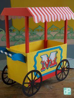 Carrocinha de circo vintage. Pode ser utilizada para a decoração da mesa principal ou dos convidados com algodão doce ou pipoca. Solicite alteração das cores e personalização, se necessário.