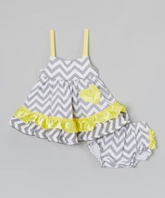 This matching dress and diaper cover set is the kind of combo that wardrobe dreams are made of. Offering plenty of comfort and dainty details, both pieces are a joy to slip on.
