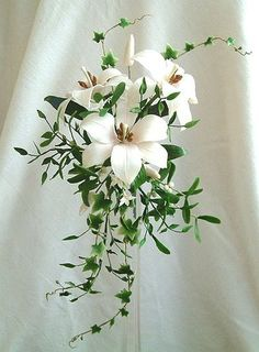These are the flowers I chose for my bouquet! They are very simple, but beautiful. I love lilies and ivy