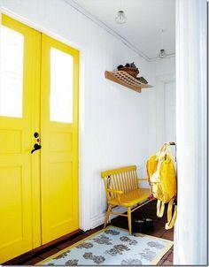 How to paint interior doors! yellow interior door via a design story
