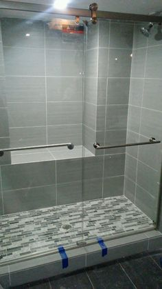 Grey large tile and sliding glass doors from Home Depot
