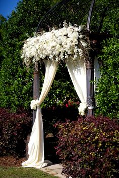 This floral arch for the wedding ceremony is exquisite! {Arden Photography}