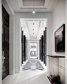 This black-and-white hallway isn't the only mesmerizing thing about this $50 million Toronto home, a - archdigest