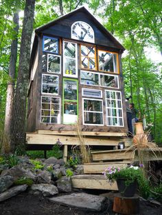 Tiny homes are less expensive to build than traditional homes, and often the owners get very hands on during the build process. (AMC)