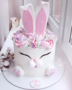 This whimsical creation features a white and pink rabbit made out of a sponge cake in either chocolate, vanilla or red velvet and topped off with flowers made out of buttercream frosting. Great for birthdays and special celebrations! Bunny Birthday Cake, White Birthday Cakes, Special Birthday Cakes, Birthday Cake With Flowers, Macaron Cake, Cupcake Cakes, 3d Cakes, Rodjendanske Torte, Rabbit Cake