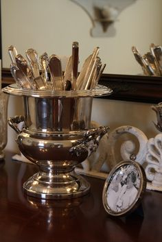 Love the idea of collecting beautiful silverware and displaying in a gorgeous urn!