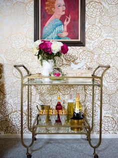 Fight the winter doldrums that January brings with trendy gold accents, like this vintage bar cart and gold floral wallpaper. Inspiration:More About This Glittery Hue