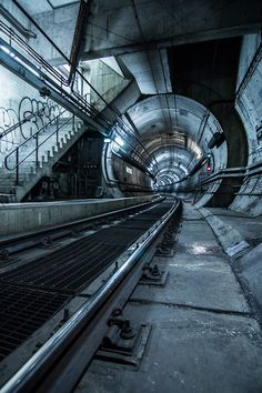 Tanner & Liz followed close behind Milo down some stairs & into an old underground railway system.  Wynne looked back at Aria & Skander & saw how nervous they were.  They were out of their element & spoiled rich kids were looked down on, on the Other Side.