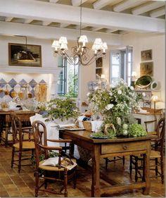 Island/table, small handmade tile on floor, beam ceiling, foliage