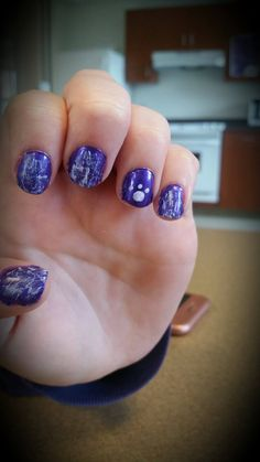 Show your Truman spirit with these simple nails! A purple background, the paw print was done with a bobby pin. For the graffiti, wipe most of the white polish off the brush and lightly swipe over the nail