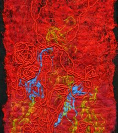 A close up of Louda Collection red raw silk hand made fabric.