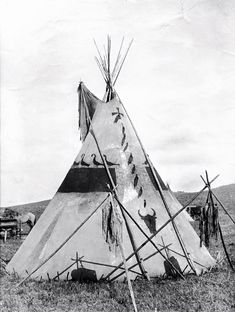 A tipi in Siksika camp. Early 1900s.