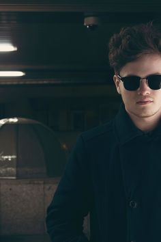 Man Wearing Black Framed Sunglasses Making Face While Taking Self Photo