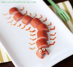 Hot dogs, AGAIN! No wonder kids love these things. They're so versatile and fun to make cute food creations with. This caterpillar is a cute after school snack, or along side dinner just to make it a little more festive. ~  64 Non-Candy Halloween Snack Ideas