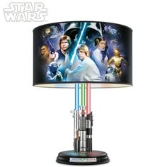 First-of-a-kind lamp's barrel shade showcases acclaimed Steve Anderson Star Wars art. Flip a separate switch and lightsabers glow blue, green and red!