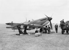 A Supermarine Spitfire Mk 1 of No. 19 Squadron RAF being re-armed between sorties at Fowlmere, near Duxford, September 1940.