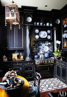 I love this dramatic navy blue kitchen and, of course, all the blue & white china!   The Enchanted Home: Ultimate kitchens round 3!
