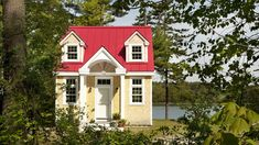 "The ""Oceanside Retreat"" is a tiny cottage designed and built by Creative Cottages in Freeport, Maine. Its exterior has dormer windows, a red roof and cedar s."