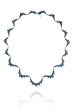 Fernando Jorge London Blue topaz necklace in black rhodium-plated gold with sapphires, from the Electric collection.