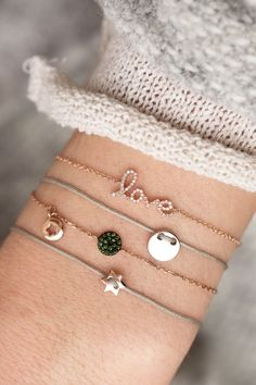 """this delicate 14k rose gold bracelet was refined with the lovingly crafted lettering """"love"""" I NEWONE-SHOP.COM"""
