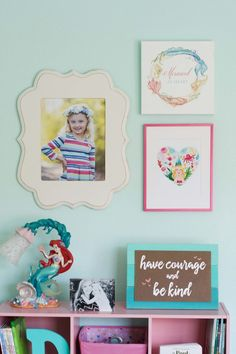 Sweet gallery wall for this little mermaid.
