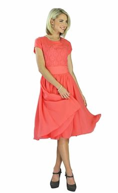 """This vibrant coral dress flaunts details that are unspeakably elegant. The Isabel dress features a lace bodice and a flowing skirt with a sheer chiffon overlay. It's perfect for weddings, parties, dances, a cruise... any occasion when your ordinary dress won't quite do!  """"Isabel"""" Modest Dress in Coral"""