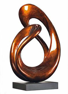 """Unity"" Contemporary Fiber Wood Sculpture, Stohans Showcase.  Spectacular medium size fiber wood sculpture with an intriguing abstract composition consisting of a vertical oval form with a loop on each end that converges at the top. The composition has an open center and both loops also have openings. This incredible fiber wood sculpture has a warm amber brown base color that is highlighted with dark brown and subdued black streaks."