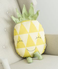 This plush pal has some real personality! The pineapple has an infectious smile and embroidered, bright green legs and stalk that perfectly compliment the yellow triangle pattern all across the front. It makes a great huggable plush for a little extra security in new places, and the tough stitching can take any snags, tosses or tugs a day of adventure can bring. The Pineapple Pal Plush sits approximately 13' high and is 9' wide.