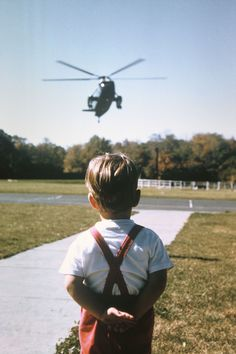 """John, Jr loved Marine One, his father's """"hebrecop"""", and he and Caroline run to greet the President on his arrival at Camp David, October 12, 1963, where Kennedy spent the weekend with his children while their mother was away."""