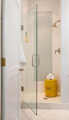 Center section of colored tile, continue white subway tile on shower floor